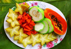 Tropical cut fruit plate Royalty Free Stock Image