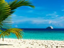 Tropical dream. Cruising yacht near the island in the Indian Ocean Stock Photo