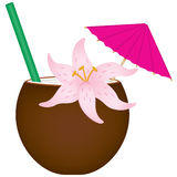 Tropical Drink. A tropical drink in coconut shell with orchid, paper umbrella and straw Royalty Free Stock Photo