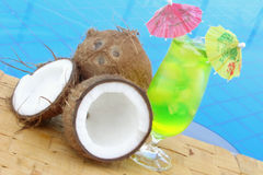 Tropical drink. Coconuts and colorful tropical drink composition Stock Image