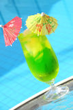 Tropical drink. Tropical green drink by a pool Stock Images