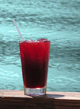 Tropical drink by pool Stock Photography