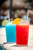Tropical drinks. At swimming pool on holidays Royalty Free Stock Photos