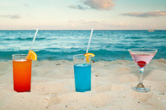 Tropical drinks on the beach Royalty Free Stock Photos