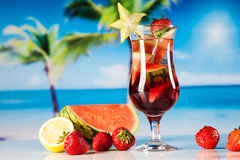 Tropical drinks on beach Stock Image