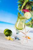 Tropical drinks on beach Stock Photo