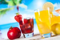 Tropical drinks on beach Stock Photography