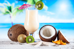 Tropical drinks on beach Stock Photography