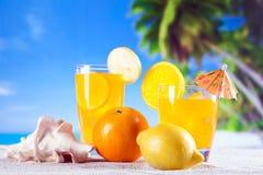 Tropical drinks on beach royalty free stock photos