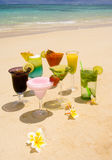 Tropical drinks on a Hawaiian beach Royalty Free Stock Photos