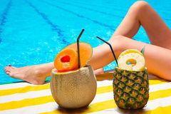 Tropical drinks at the swimming pool Royalty Free Stock Photos