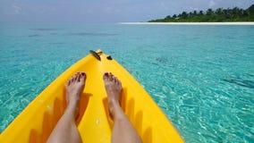 Tropical eden sea sun Kayak legs royalty free stock photos