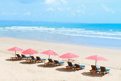 Tropical empty sandy beach with umbrellas Stock Photography