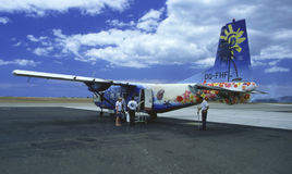 Tropical Escape. Passenges boarding colorful small inter island commuter plane in Fiji royalty free stock images