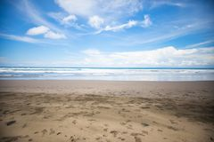 Tropical exotic beach with volcanic sand, blue sky with clouds. Nobody. Bali, Indonesia Stock Photo