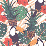 Tropical exotic flowers, pineapple and toucans seamless background Stock Photography