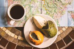 Tropical exotic fruits with coffee and Madeira map on table top view, energy break Stock Photography