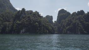 Timelapse, Tropical Thai jungle lake Cheo lan, island, wild mountains nature national park ship yacht rocks. Tropical exotic green wild mountains sinset jungles stock video