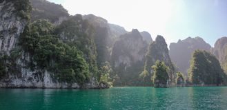 Tropical Thai jungle lake Cheo lan, wild mountains nature national park ship yacht rocks. Tropical exotic green wild mountains sinset jungles on vacations cheo Stock Images