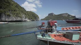 Tropical Thai jungle lake Cheo lan wood boat, wild mountains nature national park ship yacht rocks motor. Tropical exotic green wild mountains sinset jungles stock video footage