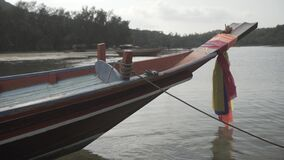 Tropical Thai jungle lake Cheo lan wood boat, wild mountains nature national park ship yacht rocks. Tropical exotic green wild mountains sinset jungles wooden stock video footage