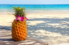 Tropical exotic pineapple cocktail at the beach Stock Photos