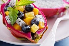 Tropical exotic salad inside a dragon fruit Stock Photos