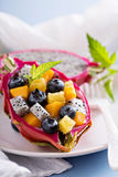 Tropical exotic salad inside a dragon fruit Royalty Free Stock Images