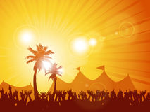 Tropical festival and crowd. Festival background with crowd and palm trees at sunset Stock Image