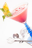 Tropical Fizz Champagne Cocktail with bar utensils close up Stock Image