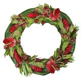 Tropical floral Christmas wreath. Wreath of tropical flowers in Christmas red and green with touches of cream in the speckled antherium and red & white candy Royalty Free Stock Image