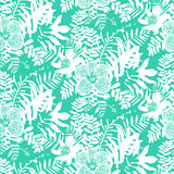 Tropical floral pattern. Vector seamless pattern with leafs and flowers inspired by tropical nature and plants like palm trees and ferns in bright colors for Stock Photos