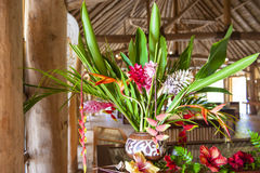 Tropical flower arrangement. Colorful tropical flower arrangement in traditional house Royalty Free Stock Photography