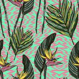 Seamless pattern with tropical leaves and flowers. vector illustration