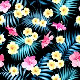 Tropical flowers and jungle palms. Royalty Free Stock Photography