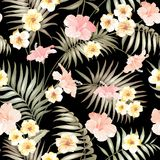 Tropical flowers and jungle palms. Royalty Free Stock Photo