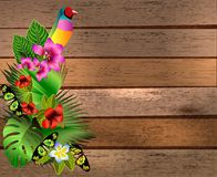 Tropical flowers and leaves and beautiful butterfly over wood, b Royalty Free Stock Images