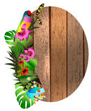 Tropical flowers and leaves and beautiful butterfly over wood, Royalty Free Stock Images