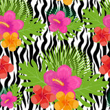 Tropical flowers, plants, leaves and animal skin seamless pattern. Summer Endless floral background. Paradise repeating Stock Photos