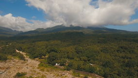 Tropical forest in the mountains. Camiguin island Philippines. Mountains with sky and clouds. Rainforest covered with green vegetation and trees in the stock video