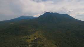 Tropical forest in the mountains. Camiguin island Philippines. The small village in the mountain jungle with huts.Rainforest covered with green vegetation and stock video