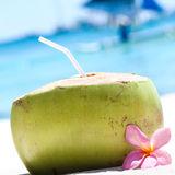 Tropical fresh cocktail on white beach Stock Photography