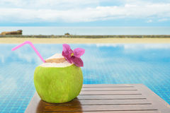 Tropical fresh coconut cocktail with pool and beach in ocean, Phuket ,Thailand Stock Photography
