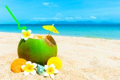 Tropical fresh coconut cocktail on white beach. Vacation concept Stock Photography