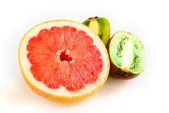 Tropical fresh fruit grapefruit, apple and a kiwi stock photos