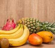 Tropical fresh fruit set and juice smoothies isolated with wooden background. Tropical fresh fruit set and juice smoothies isolated with the wooden background royalty free stock image