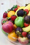 Tropical fresh fruits. In a bowl with banana, orange, apple, strawberry etc royalty free stock images