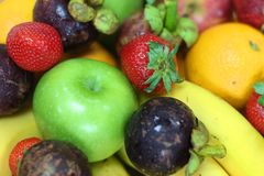 Tropical fresh fruits. In a bowl with banana, orange, apple, strawberry etc stock photography