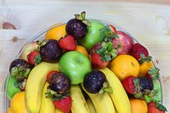 Tropical fresh fruits. In a bowl with banana, orange, apple, strawberry etc stock image