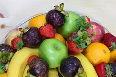 Tropical fresh fruits. In a bowl with banana, orange, apple, strawberry etc stock photos